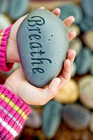 Child holding Breathe stone
